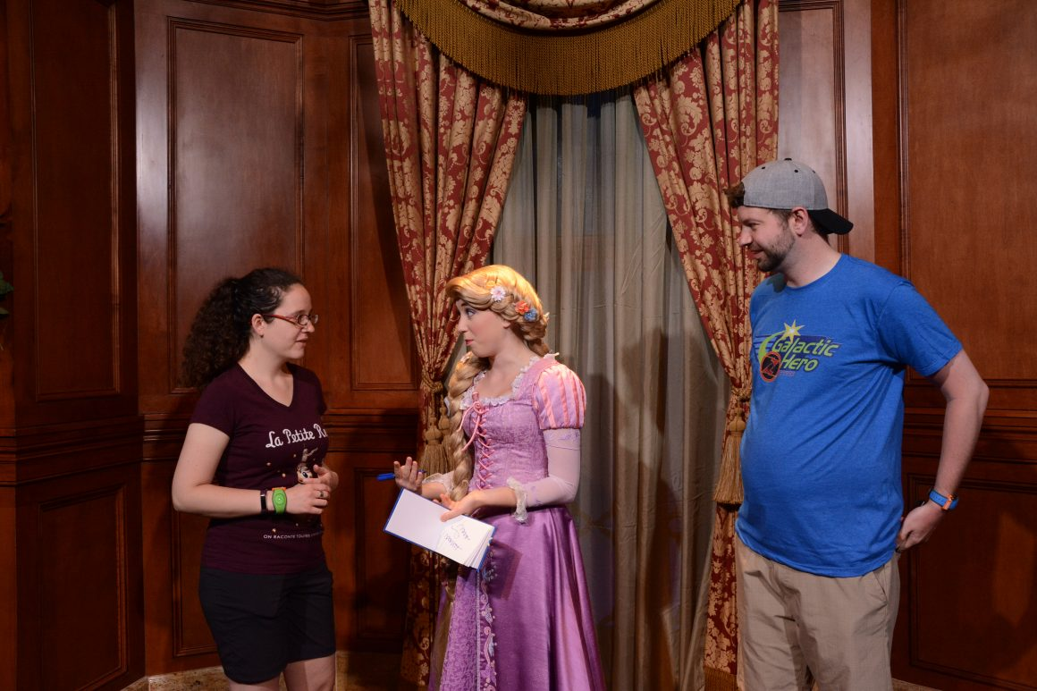 Rapunzel Signing an Autograph